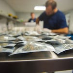A strain of marijuana called Lavender is packaged for distribution at Compassionate Sciences in Bellmawr.