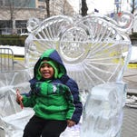 Braelyn Young, of Detroit, enjoys the ice throne during the 2015 Meridian Winter Blast in downtown Detroit.
