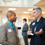 UWF student Chase Carroll and Northwest Mutual's Tom Vaughn speak during a recent networking event. The UWF Executive Mentor Program matches local business leaders with business students to help them develop soft skills and choose their career path.