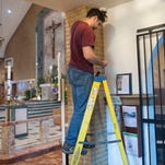 Father Joe Capella looks at the repaired stained glass windows following the vandalism at St. Lawrence Church at Our Lady of Guadalupe in Lindenwold. Tuesday, May 3, 2016.