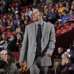 Taking charge: Reinking adjusts to life as a head coach