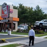 Winslow Police SUV crashed into the Dunkin Donuts on the White Horse Pike in Berlin Borough after colliding with another vehicle. Friday, September 19, 2014.