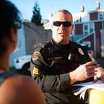 Sgt. Bill Johnson, Jr. of the Gloucester City Directed Patrol Unit speaks with resident Lucy Melendez about an incident on her block.