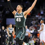 MSU's Denzel Valentine celebrates after the Spartans' 60-54 win over Virginia Sunday in Charlotte, N.C. MSU is in its 13th Sweet 16 in 18 years, two wins from a seventh Final Four under Tom Izzo.