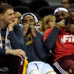 Cleveland Cavaliers center Timofey Mozgov (20), Cleveland Cavaliers guard J.R. Smith (5) and Cleveland Cavaliers forward LeBron James (23) laugh on the bench during the fourth quarter against the Charlotte Hornets at Quicken Loans Arena. The Cavs won 129-90. Smith and Mozgov have been major reasons James has been able to settle in and the Cavs are on a torrid run.