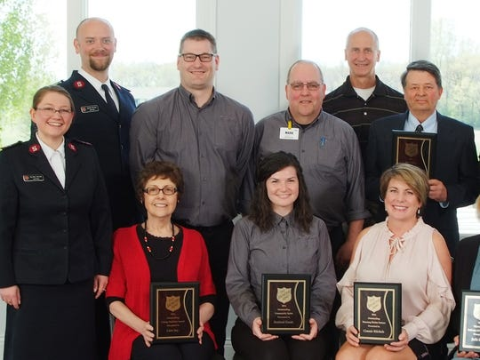 The Salvation Army of Fond du Lac County Captains with 2016 Outstanding Leaders of Compassion. Pictured are, front row, from left: Capt. Telinda Wilson; Sue Schierstedt, Care INC; Kate Frank, Festival Foods; Connie Michels; and Julie Lavey; back row: Capt. Steve Wilson, Ryan Pelot and Mark Schabel, Festival Foods; Tom Frantz, The Hotel Retlaw; Steve Zeigler, Salvation Army Advisory Board member; and Steve Frantz, The Hotel Retlaw.