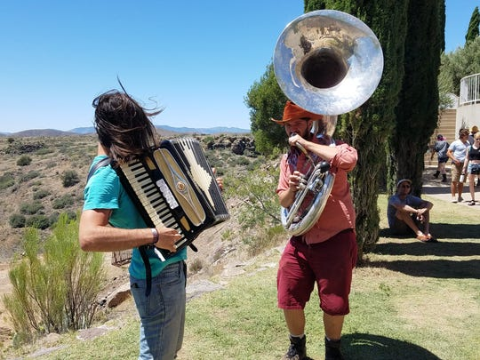 Polka musicians play for passerby at FORM Arcosanti.