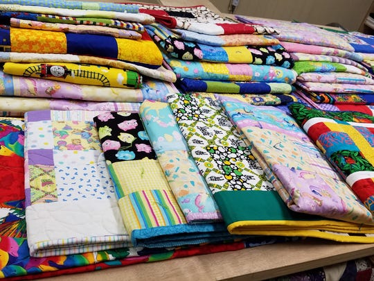 Members of the Bridgewater-based Pieced Together Quilters made quilts for all of the children served by CASA SHaW.