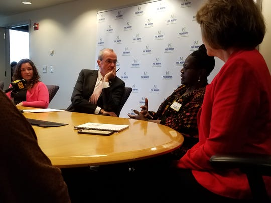 Phil Murphy speaks with women's health advocates during an event at his Newark campaign office on June 7, 2017.