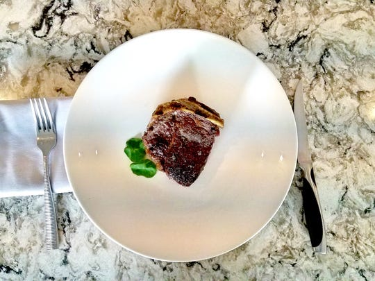12-ounce Bone-in Filet Mignon from Char Steak & Lounge.