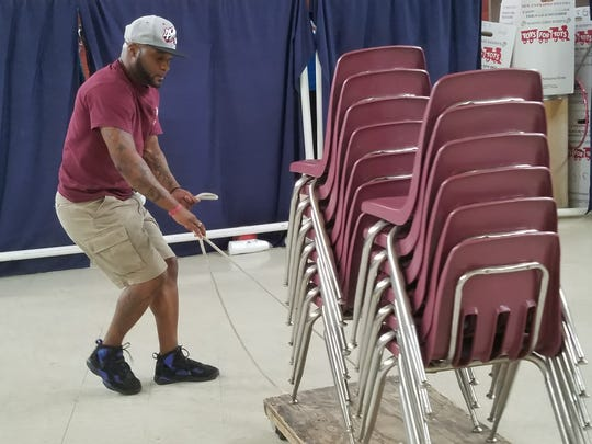 Salvation Army workers cleared out the Abilene facility's gym to hold cots for storm-displaced persons Friday.