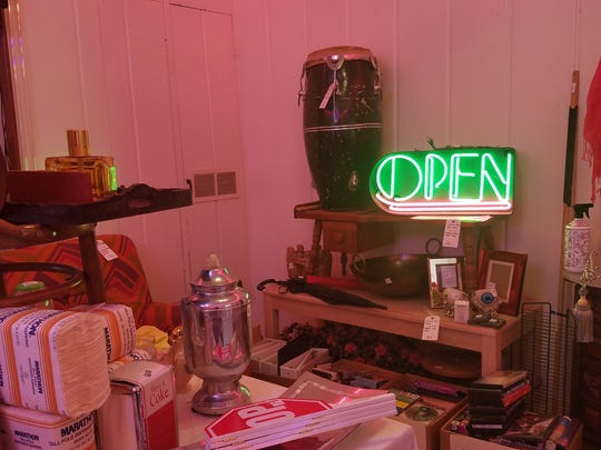 From neon to percussion to one staring eye, these are some of the items in Susan King's estate sale.