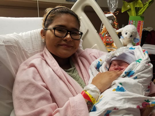Mother Marissa Cruz holds baby Elena Jasmine Ramirez on Monday, Jan. 1, 2018. Baby Elena is the first baby born in the new year in Corpus Christi.