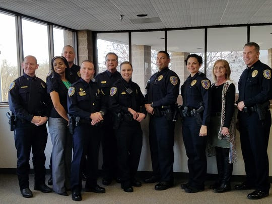 Members of the Abilene Police Department celebrate the arrival of three new officers into their ranks Friday.  Clarissa Haynes, Luis Aguilar, and Jessica Shafer became full APD officers.