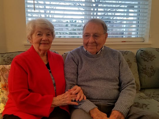 Martha and Lee Brewer pose at their home in Jackson, Tennessee. Lee looks at Brewer the way he's been looking at her for nearly 70 years.
