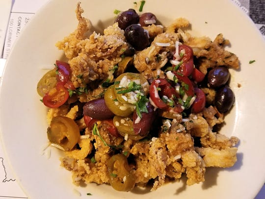 The Sicilian calamari is a spicy appetizer served at