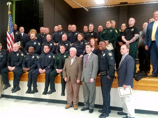 Crisis Intervention Team training program graduates pose for a picture at the West Tennessee Regional Training Center in Denmark, Tennessee.
