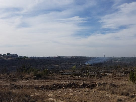 View of the Ratliff Road Fire after crews completed containment lines on Monday. A home directly saved by firefighters can be viewed in the background.