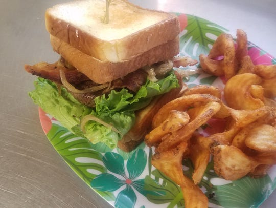 One particularly popular item at Bilda's is the grilled cheese burger which features a third-pound patty, bacon, caramelized onions, lettuce and tomato between two grilled cheese sandwiches.