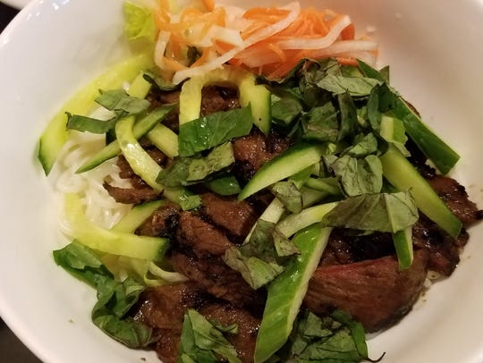 The warm beef noodle bowl tastes delicious at Yellow