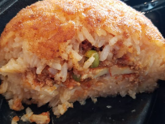 Arancini, available with or without meat, is softball-sized.