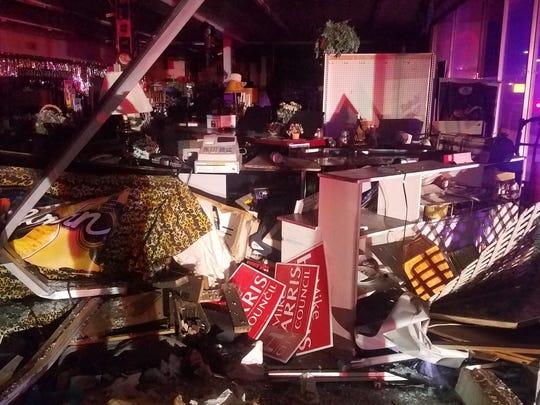 A van slammed into Tim Spear's Music City late Sunday