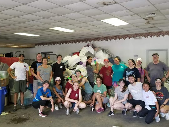 Dedicated volunteers collect reusable materials from