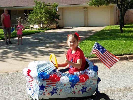 Kids of all ages participate in River Oak's yearly Fourth of July parade, celebrating its 10th year.