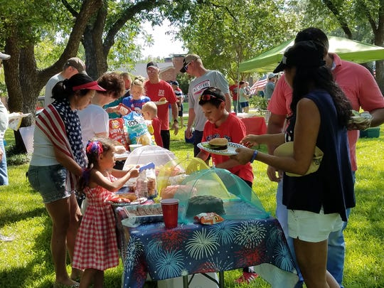 After a fine 4th of July parade, folks in the River Oaks neighborhood gathered to share some good, home-cooked food.