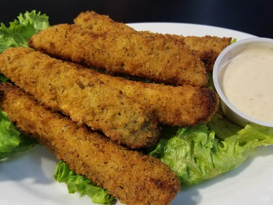 Deep-fried pickles have a very crisp breading and sharp