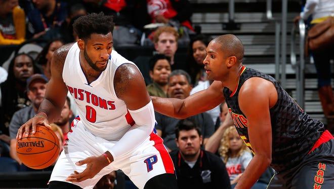 Atlanta's Al Horford defends against Pistons center Andre Drummond.