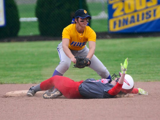 Clyde's Kennedy Arndt watches a Huron runner slide in safely Monday.