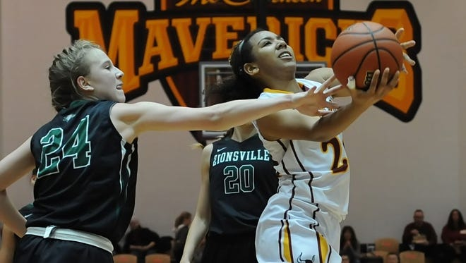 Zionsville's Maddie Rolan gets a touch on the ball as McCutcheon guard Alanah Owens drives in for a layup during the girls basketball sectional at McCutcheon Saturday night.