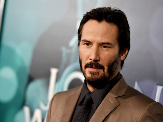 Keanu Reeves helps fellow airplane passengers through emergency landing stress, logistics