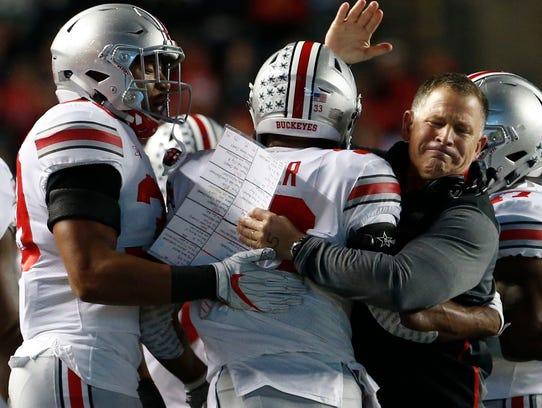 Ohio State linebacker Dante Booker gets congratulations