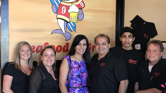 Making Cheers Seafood & Grill in Rockledge a friendly place to eat and hang out are, from left, Colby Spaulding, Tracy Heck, Avani Shastri, Neil Shastri, Yogi Shastri and Jeff Colby.