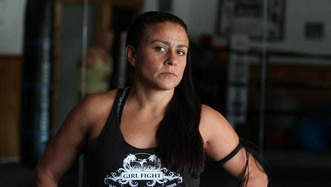 Prairie Rugilo, a 36-year-old semi-professional muay thai fighter and owner of Girl Fight, an all-female martial arts school in Toms River, who will featured in Her Powerful Portrait on app.com, stands in her gym Thursday, May 14, 2015. Staff photo Tanya Breen