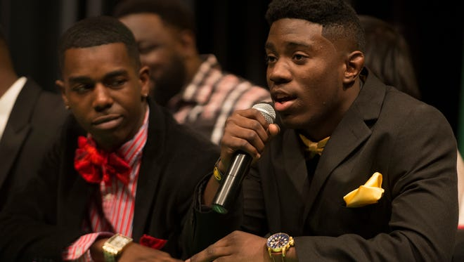 Carver football player Skylar Calhoun speaks before signing with Grambling State University on Wednesday, Feb. 4, 2015, at Carver High School in Montgomery, Ala.