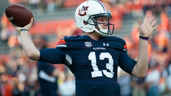 Auburn quarterback Sean White (13) throws a pass before the Iron Bowl NCAA college football game between Auburn vs. Alabama, Saturday, Nov. 28, 2015, at Jordan-Hare Stadium in Auburn, Ala.
