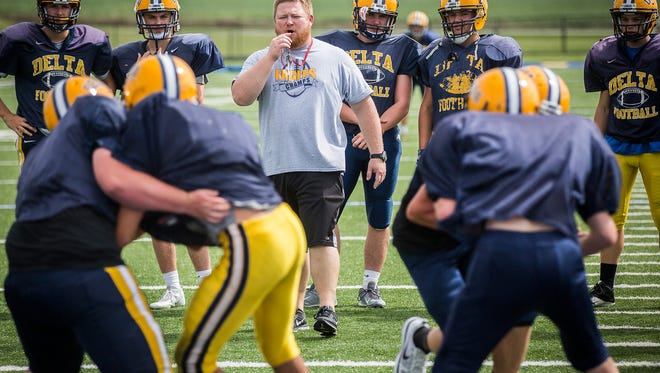 Delta head coach Chris Overholt works with players during practice Tuesday at Delta High School.