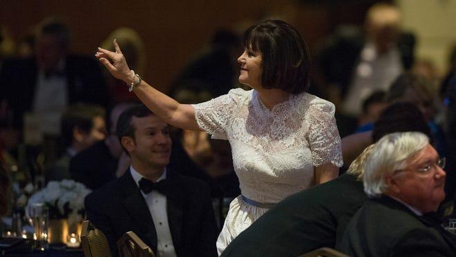 Karen Pence waves to Dan Quayle across the ballroom at the Indiana Society Ball at the Grand Hyatt, Washington D.C., Friday, Jan. 19, 2017.