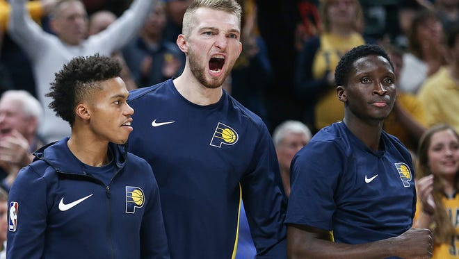 From left, Indiana Pacers guard Joe Young (3), Indiana Pacers forward Domantas Sabonis (11) and Indiana Pacers guard Victor Oladipo (4) watch second half action between the Indiana Pacers and Brooklyn Nets in the home opener at Banker's Life Fieldhouse, Indianapolis, Wednesday, Oct. 18, 2017. The Pacers won, 140-131.