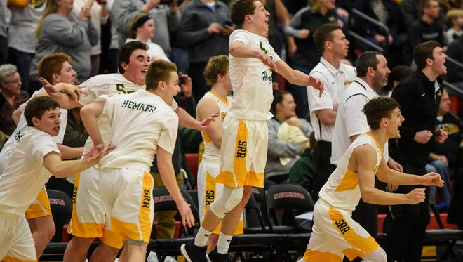 Sauk Rapids players react on the bench in the final seconds of the Section 8-3A championship game Thursday, March 25, in Alexandria.