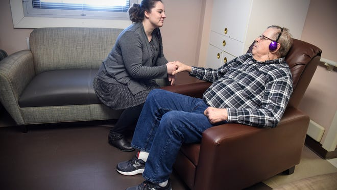 Sarah Rueter works with Michael Van De Berg in the Behavioral Recovery Program area Tuesday, March 27, at the St. Cloud VA Health Care System in St. Cloud.