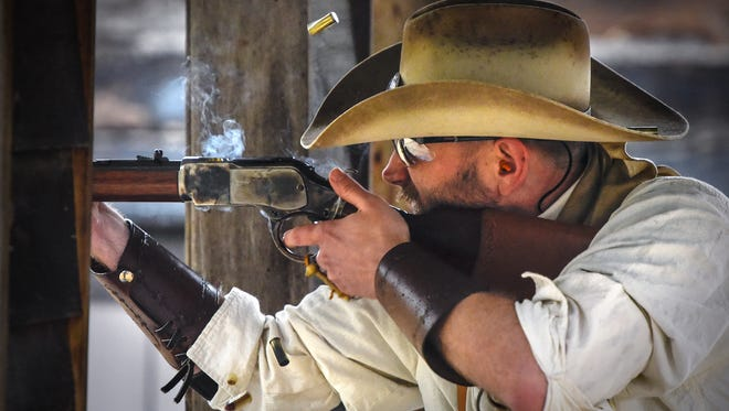 Justin Lappin, aka Hillbilly Bert, concentrates on a rifle station during a Granite City Gunslingers shooting event Saturday, June 9, at the Kimball Rod and Gun Club. Justin L