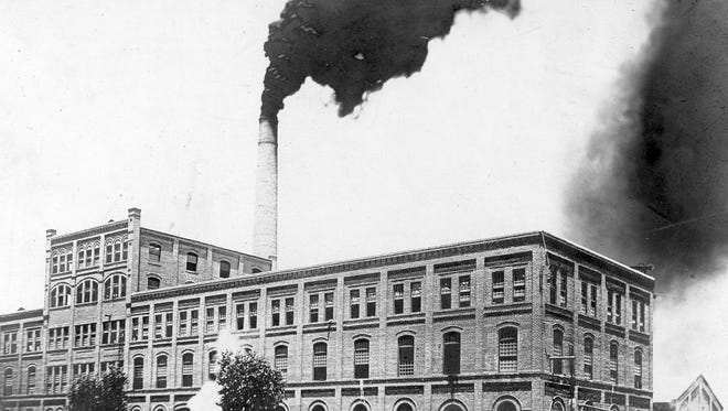 The south-facing front of the Sugar Beet Factory is pictured here in 1915. Smoke belches from the gigantic smokestack as sugar beets are processed into raw sugar near the end of its sugar-producing days. Empty and unused for years, the building still stands near Glendale and 52nd avenues.