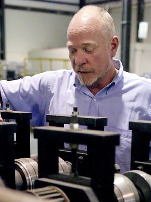 Scott Smith, general manager of Super Stud Building Products Inc., inspects a machine.