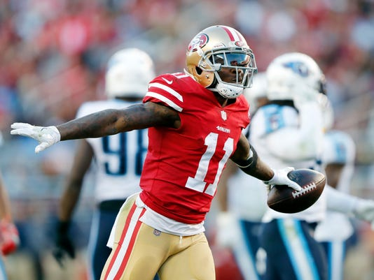 San Francisco 49ers wide receiver Marquise Goodwin (11) celebrates after making a catch against the Tennessee Titans during the second half of an NFL football game, Sunday, Dec. 17, 2017, in Santa Clara, Calif. (AP Photo/John Hefti)