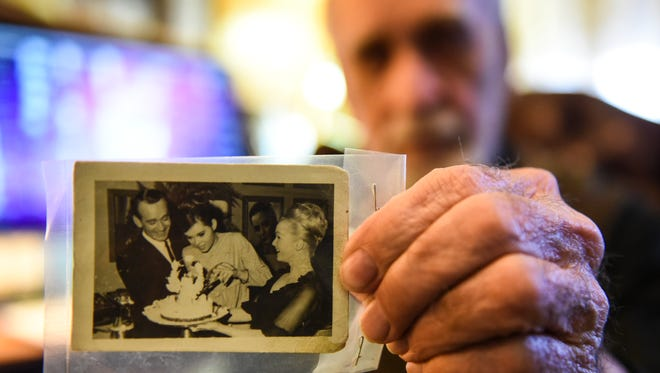 Myerstown resident John Wiest holds a photo from his wedding reception in 1965 that Debbie Reynolds (right, in the photo) threw for he and his wife.