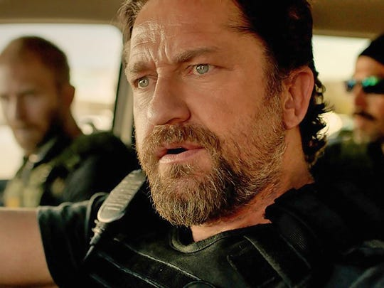 "Gerard Butler stars in ""Den of Thieves."""